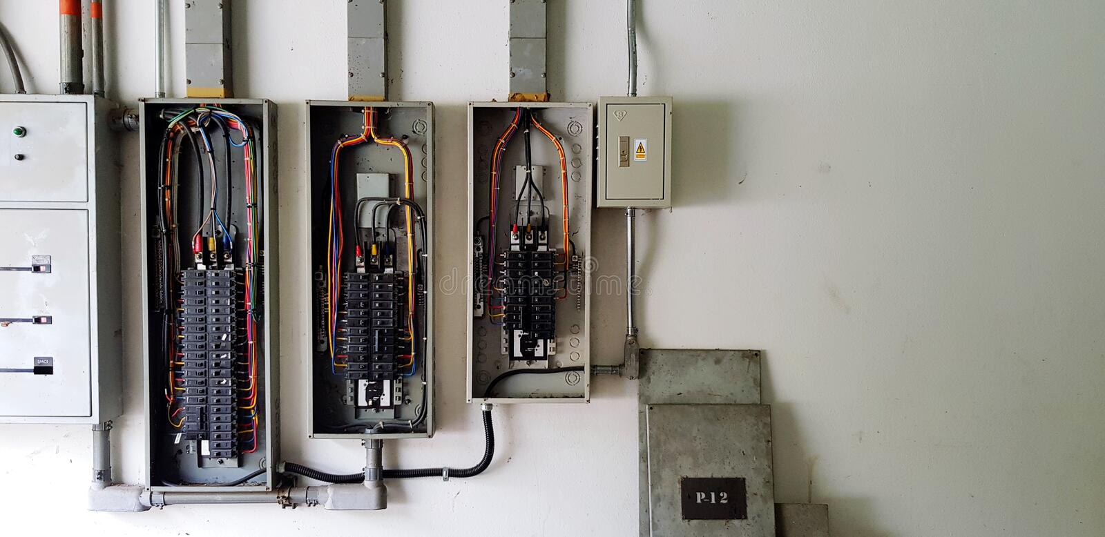Many circuit breaker for distribute electricity in building on white wall. With right copy space in main electrical room royalty free stock photo