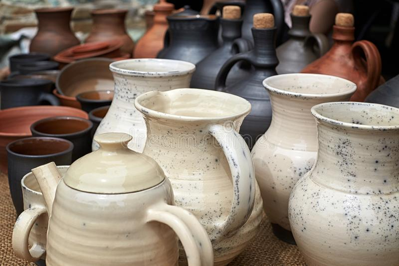 Many clay jugs with locks and vessels royalty free stock photography