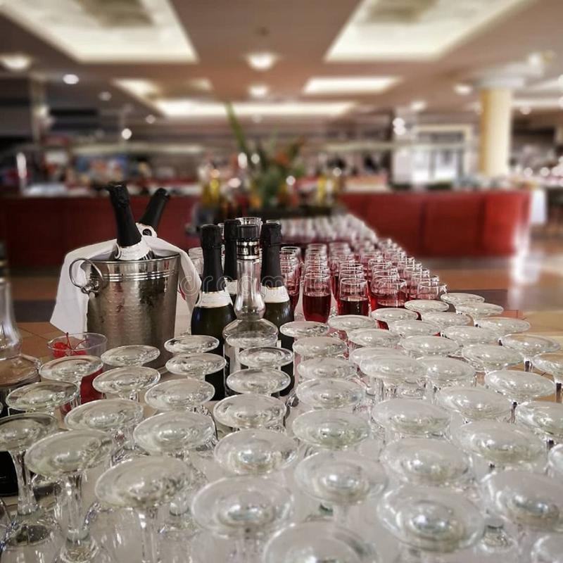 Many clean glasses and champagne close up royalty free stock photography