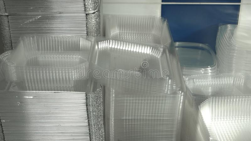 Many clean plastic boxes for food packaging. Pile of disposable plastic containers for take away food stock photos
