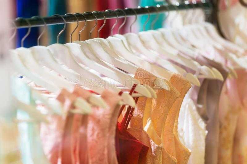 Lots of clothes on hangers royalty free stock images