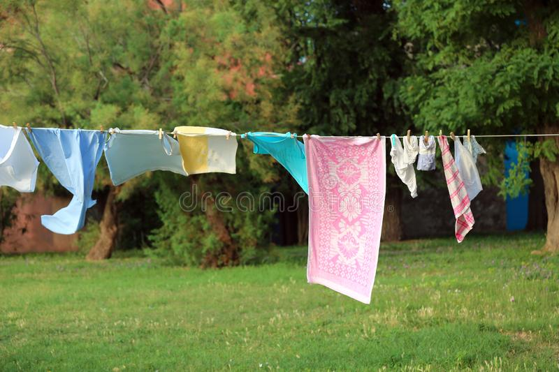 clothes hanging and dressed to dry outdoors on the clothesline stock photos