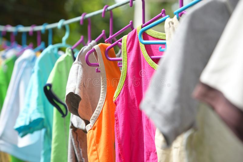 Many clothes are hung on the clothes drying rack. stock photography