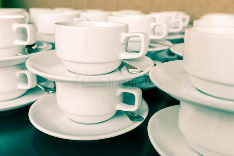 Many coffee cup prepared for coffee break during seminar event. Many white coffee cup prepared for coffee break during seminar event royalty free stock image