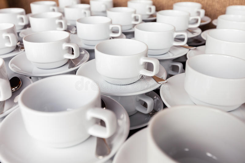 Many coffee cup prepared for coffee break during seminar event. Many white coffee cup prepared for coffee break during seminar event royalty free stock photos
