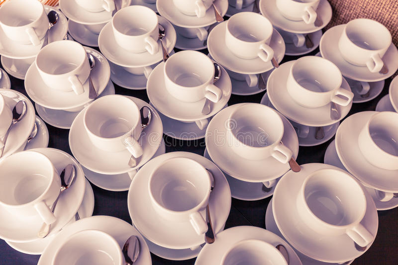 Many coffee cup prepared for coffee break during seminar event. Many white coffee cup prepared for coffee break during seminar event stock photo