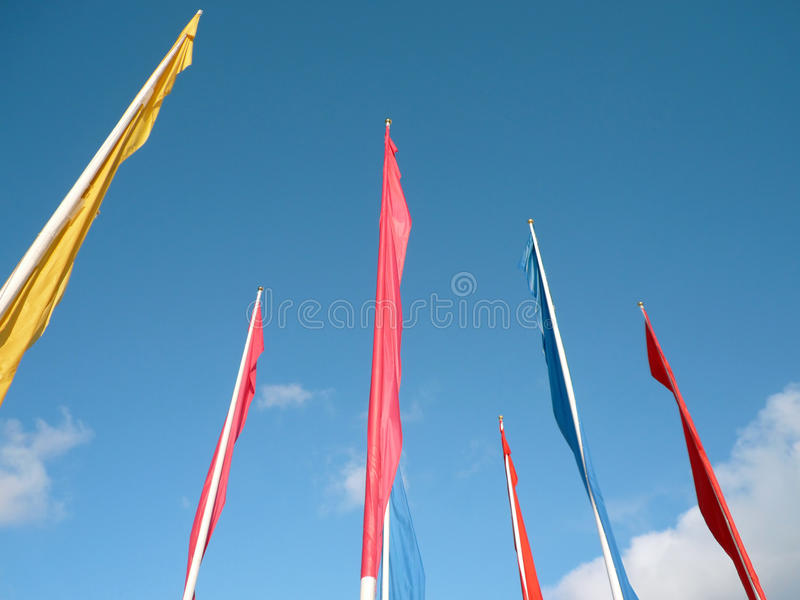 Many color flags. On sky background royalty free stock photography