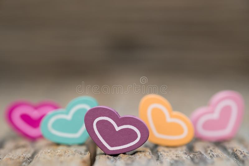Many color Heart on wooden background. Copy space Valentines day concept stock image