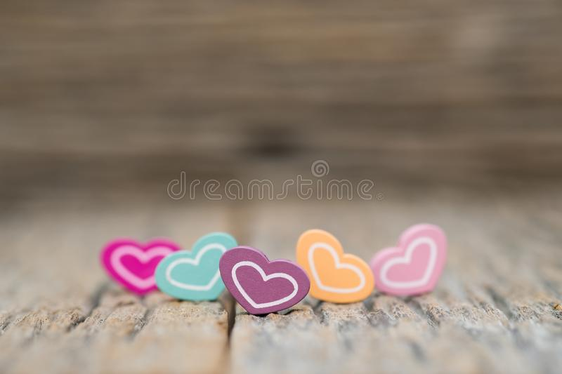 Many color Heart on wooden background. Copy space Valentines day concept stock images