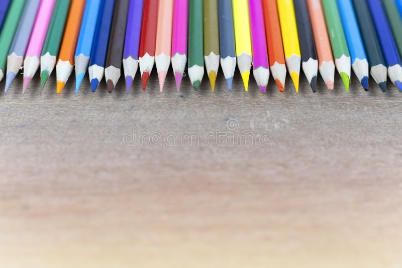 Many color pencils on wood background with copy space for text or design. Education concept. Many color pencils on wood background with copy space for text or royalty free stock photography