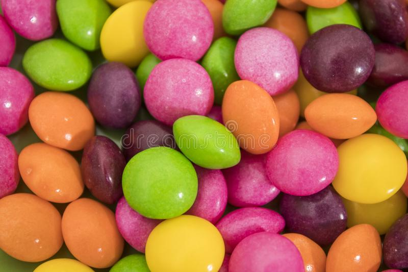Many colored candies in a background composition stock photo