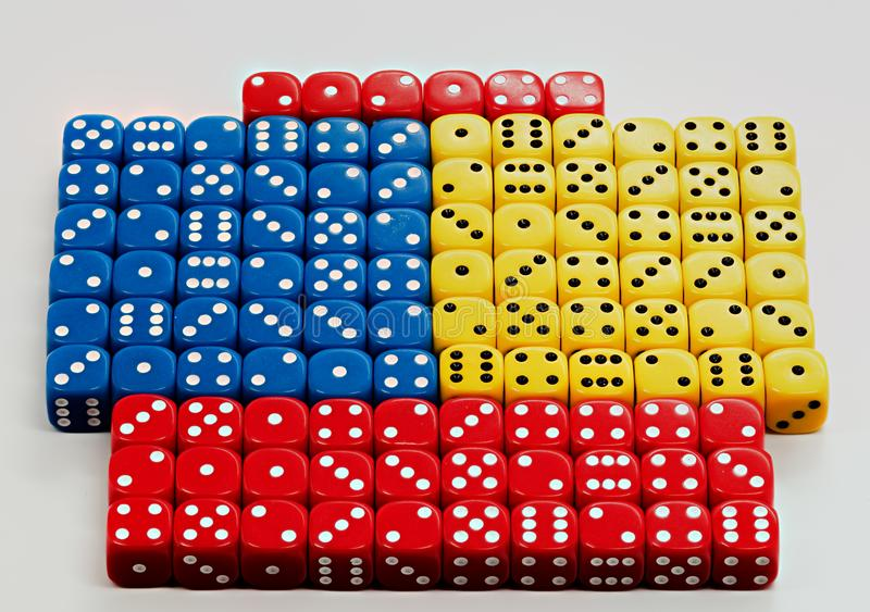Many colored dice with random numbers being displayed stock photography