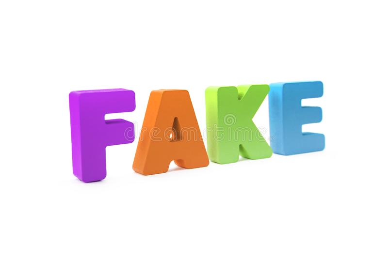Many-colored isolated wooden word FAKE made with 3d text effect. Concept of false information, distortion of fact. Misinformation stock photo