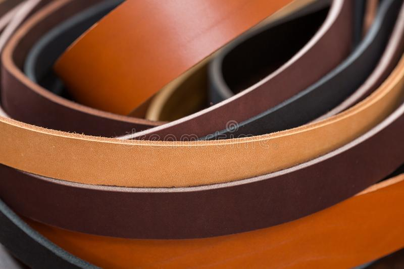 Many colored leather pieces for sewing belts. royalty free stock photography