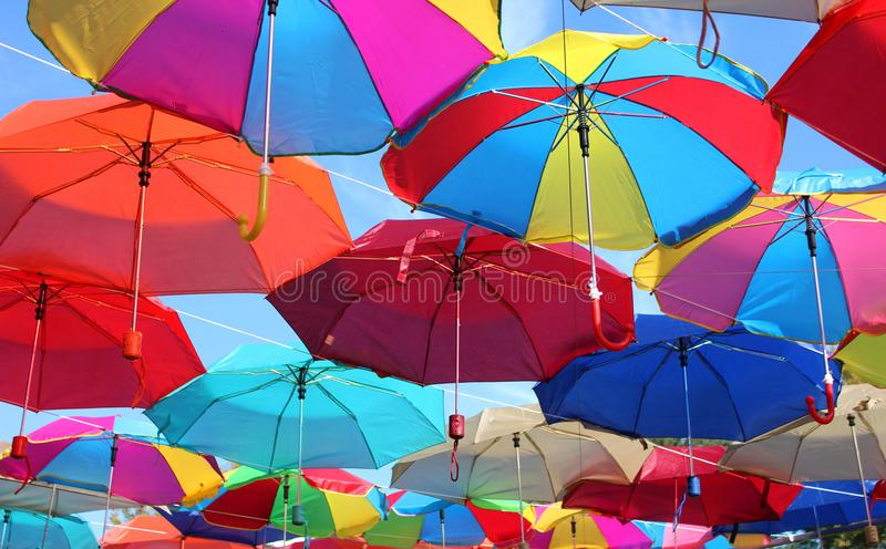 Many colored umbrellas on the street. royalty free stock photos
