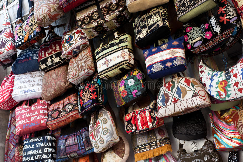 Many colorful bags for women. Many things are selling in Grand Bazaar (Grand Market) Istanbul, Turkey stock image