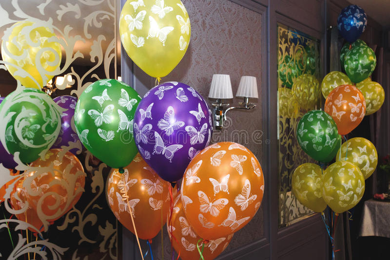 Many colorful balloons with butterflies, decoration in restauran stock photo