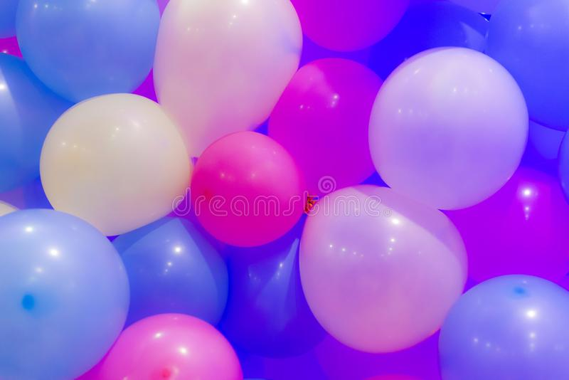 Many colorful balloons decorated wall as background. stock photography