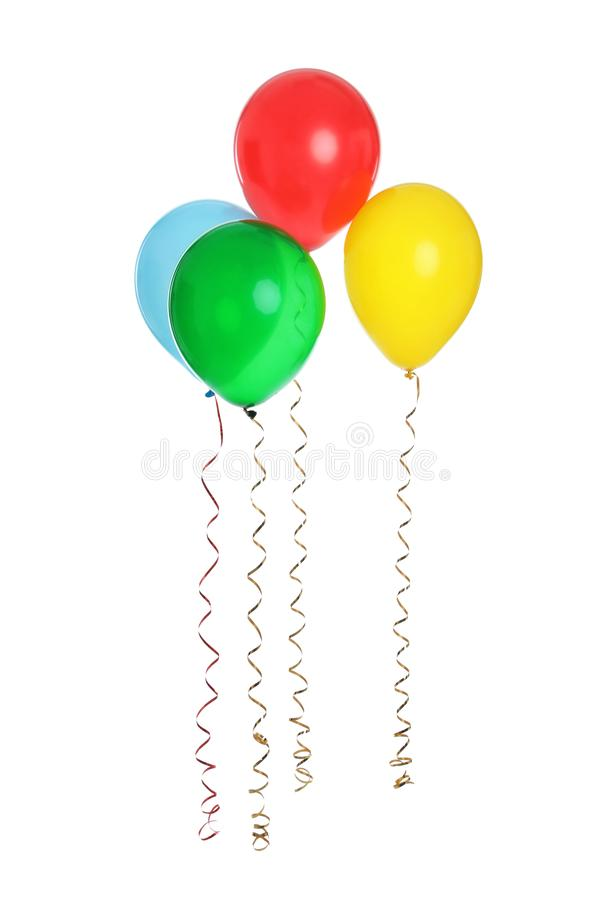 Many colorful balloons floating on white. Background stock photos