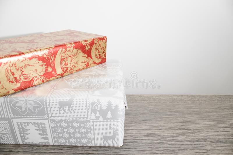 Many colorful christmas gifts on a wood table royalty free stock image