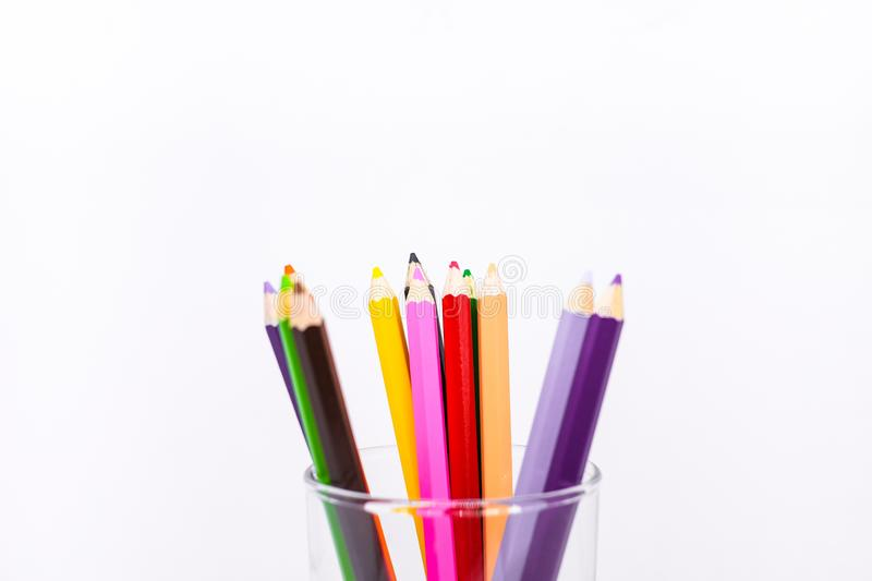 Many colorful crayon or pastel wooden pencil in the glass. royalty free stock images
