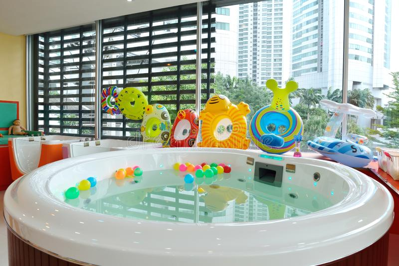 Many Colorful inflatable balls on water and many design rubber rings for kid play stock photos