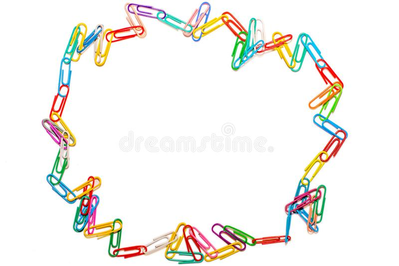 Wild circle of colored paper clips on white background royalty free stock photo