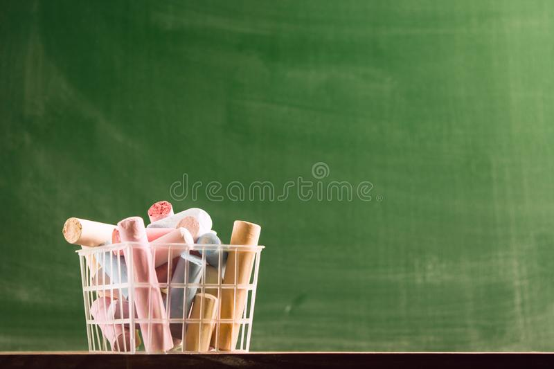 Many colorful piece of chalk in plastic basket. Back to school concept. Beginning school year. Selective focus royalty free stock image
