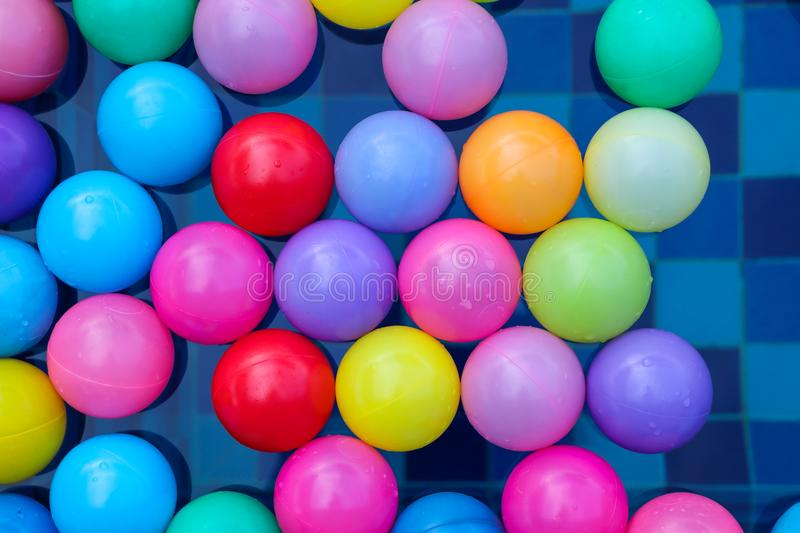 Many colorful plastic balls floating in pool royalty free stock photos