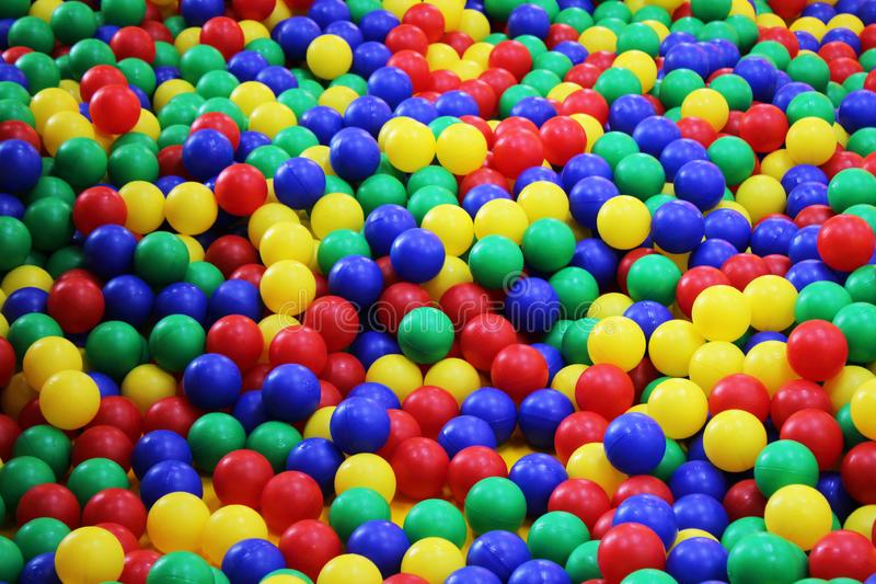Many colorful plastic balls in a kids` ballpit at a playground. royalty free stock photo