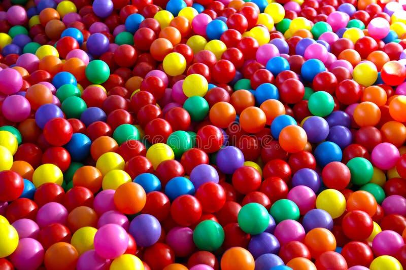Many colorful plastic balls stock image