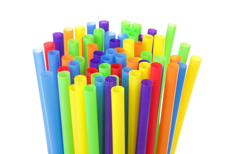 Many colorful plastic straws with opening upwards isolated stock images