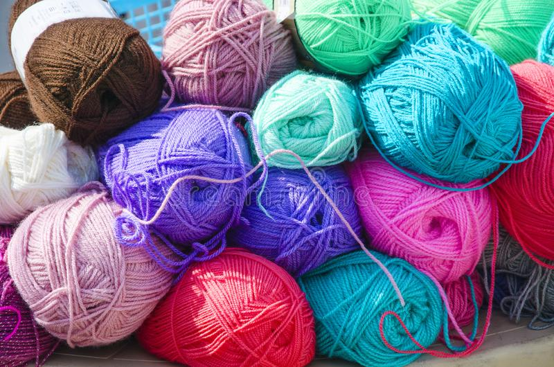 Many colorful skeins of thread for knitting. Lie on each other for sale royalty free stock photos