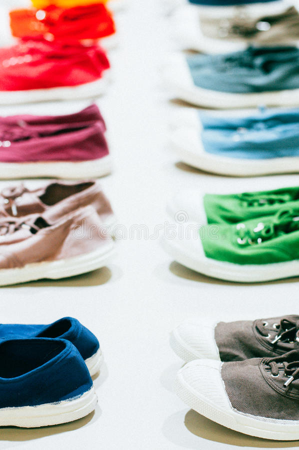 A many of colorful sneakers. Gym shoes, woman running shoes royalty free stock photo