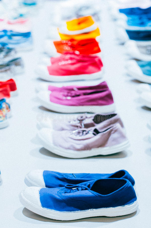 A many of colorful sneakers. Gym shoes, woman running shoes royalty free stock photos