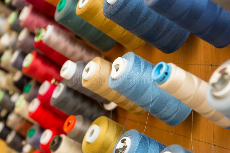 Many colorful spools of thread royalty free stock photography