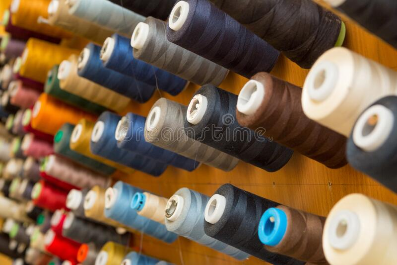 Many colorful spools of thread stock images