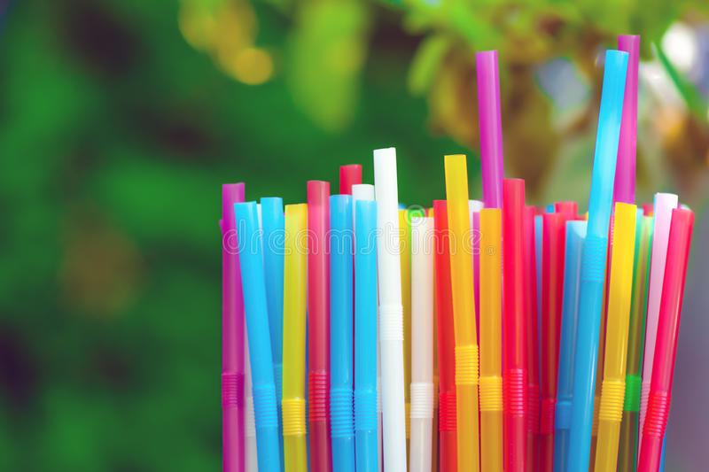 Many colorful tubes for drinks, water, juices, cocktails royalty free stock image