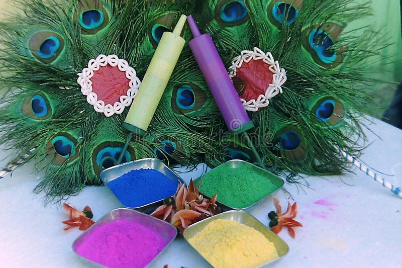 Many colors of decorated holi - with peacock feather. Many colors of holi Many colors of decorated holi - with peacock feather stock photography