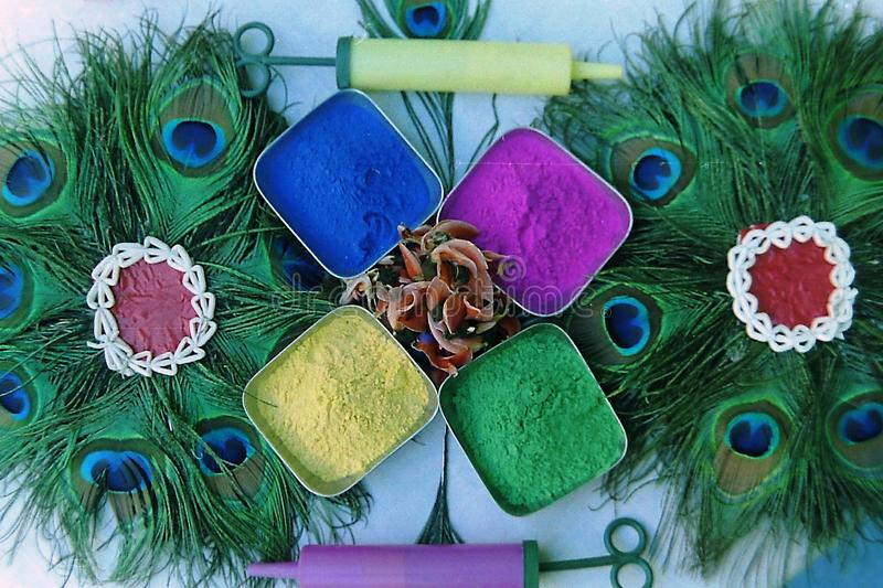 Many colors of decorated holi - with peacock feather-1.  royalty free stock photography
