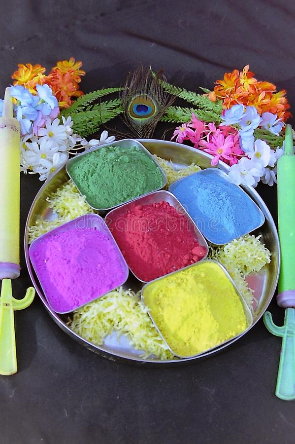 Many colors of holi decorated in a plate.  stock photo