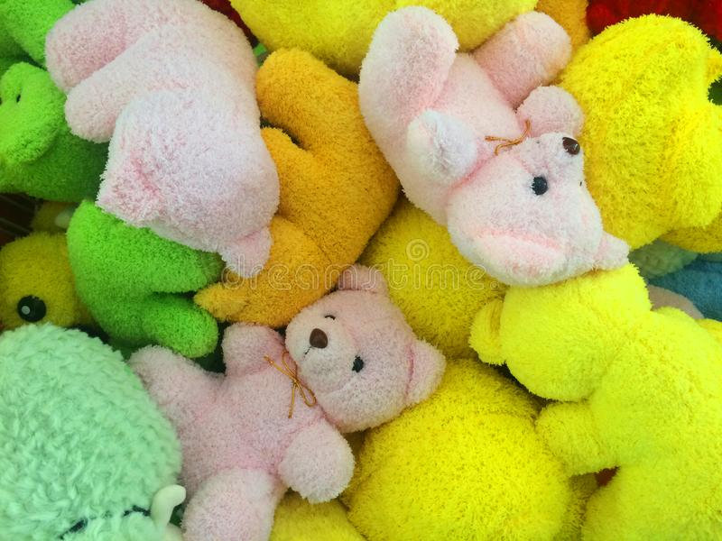 Many colors of teddy bears put together. At toy store stock photos
