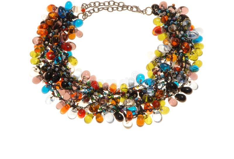 Many-coloured plastic necklace stock image