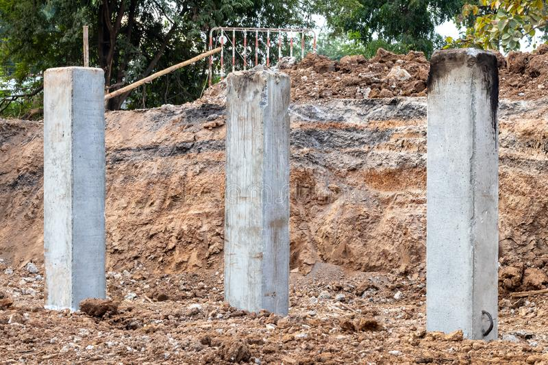 Many concrete poles in the excavated soil for construction. royalty free stock photography