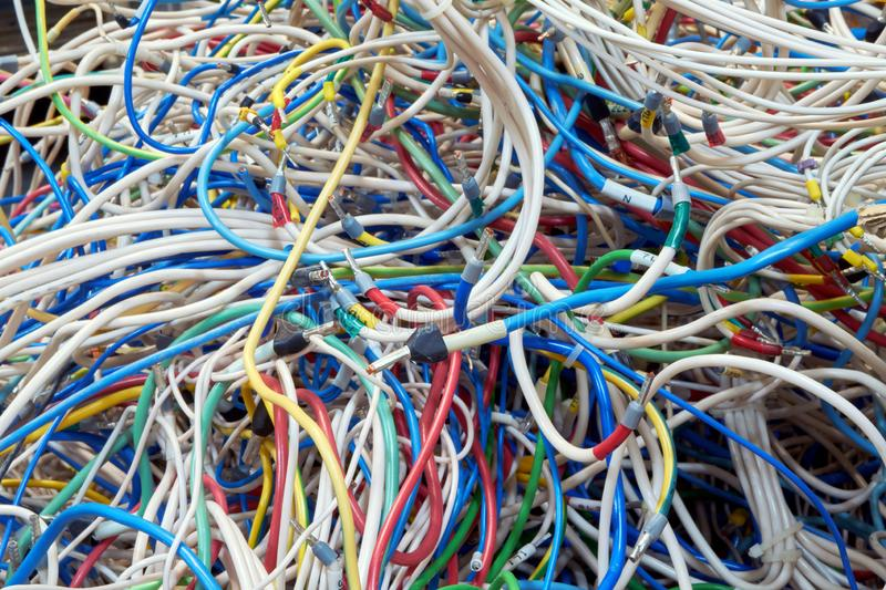 A lot of very tangled electrical wires of different colors stock photo