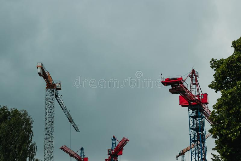 Many construction cranes on blue sky - construction site royalty free stock photo