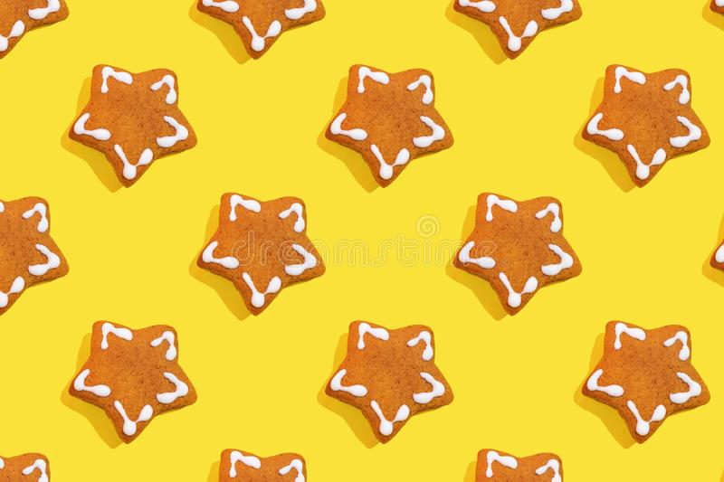 Many of cookies on color background. Many of cookies on yellow background. Gingerbread in shape of Christmas star. Many sweets cookie spattern. New Year Xmas and stock images
