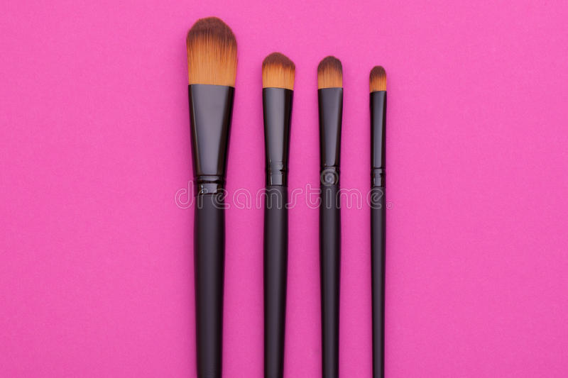 Many cosmetic brushes, overhead view. It is a good idea for cosmetics advertising stock photos