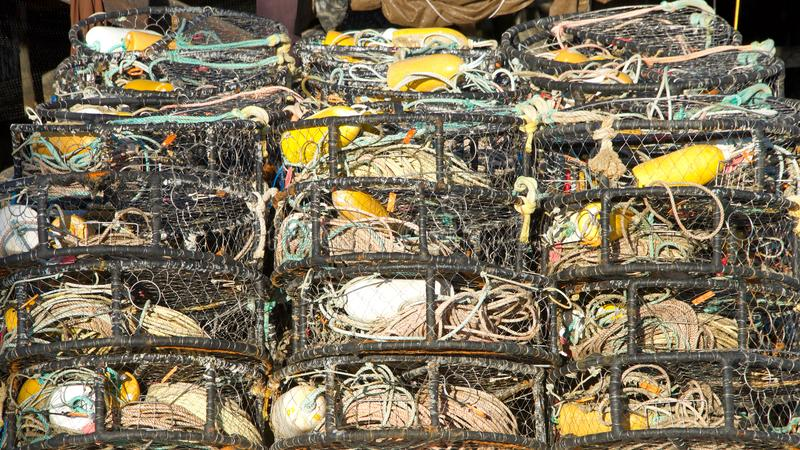 Crab cages stacked in rows. Many Crab cages stacked. Crab traps are used to bait, lure, and catch crabs for commercial or recreational use. Crabbing or crab royalty free stock photos