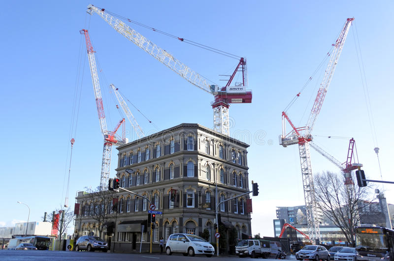 Many cranes in a building site in Auckland CBD. stock photo